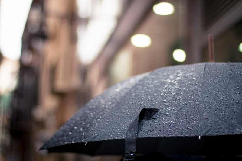 raining umbrella health