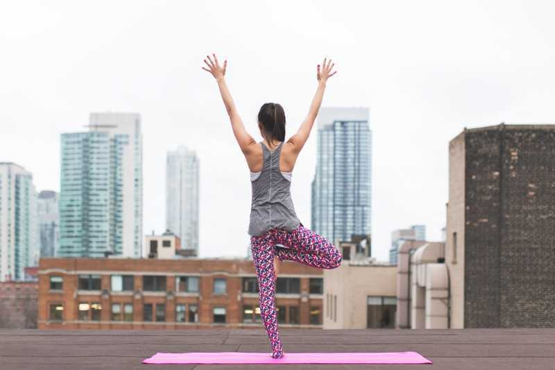 yoga on city rooftop relax for beautiful skin