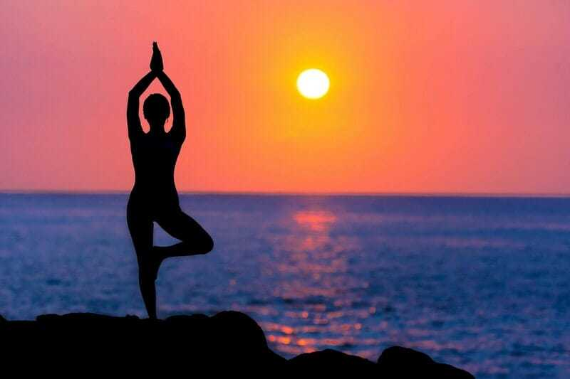 yoga at sunset for body relxation